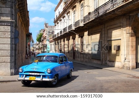 HAVANA - FEBRUARY 27: People ride Classic car on February 27, 2011 in Havana. Recent change in law allows Cubans to trade cars again. Old law resulted in very old fleet of private owned cars in Cuba. - stock photo