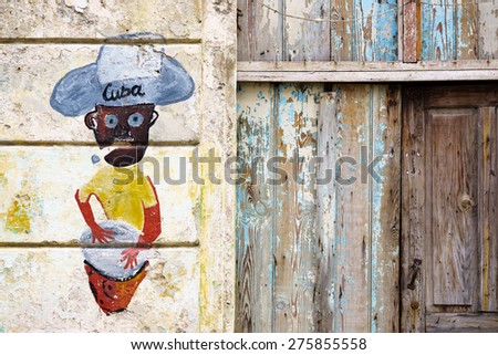 HAVANA, JAN 26: Graffiti of Cuban man with cigar on January 26, 2015 in Havana, Cuba. When visiting Cuba, it was hard to tell the difference between graffiti and murals commissioned by the government - stock photo