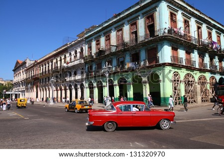 HAVANA - JANUARY 30: Cubans drive Classic American car on January 30, 2011 in Havana. Recent change in law allows the Cubans to trade cars again. Most cars in Cuba are very old because of the old law. - stock photo