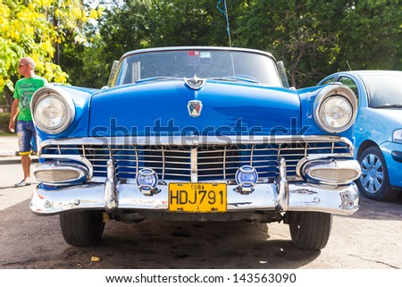 HAVANA-JUNE 21:Front view of an old convertible car on June 21, 2013 in Havana.These classic cars are a worldwide famous sight and a tourist attraction of the island - stock photo