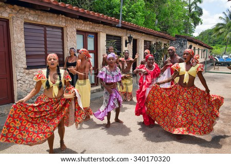 HAVANA - MAY 19: African folk dance in the street by an unknown group of African folk dance on May 19, 2013 in Havana, Cuba - stock photo