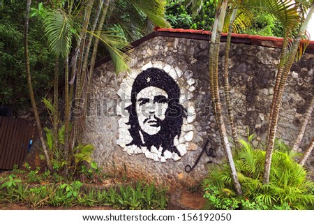 HAVANA - MAY 19: graffiti artwork of Che Guevara on wall in Havana, Cuba on May 19, 2013. Che Guevara was a major figure in the Cuban revolution. - stock photo