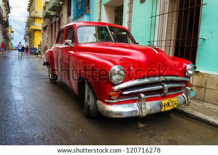 HAVANA-NOVEMBER 28:Old classic Buick in a shabby neighborhood November 28,2012 in Havana.Thousands of vintage cars are still in use in Cuba and they have become an iconic view of the cuban cities - stock photo