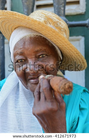 HAVANA -  OCTOBER 28, 2012: Cubans woman smoking cigar in Havana, Cuba on  October 28, 2012.