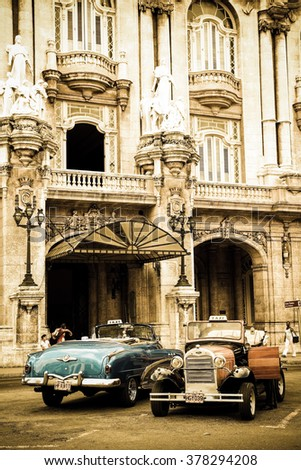 HAVANA, SEP 9: Two well-preserved old cars on September 9, 2011 in Havana. Two classical models, Cadillac Series 62 Convertible 1952 and Ford A 1930, now taxis, in front of the hotel Telegraph. - stock photo