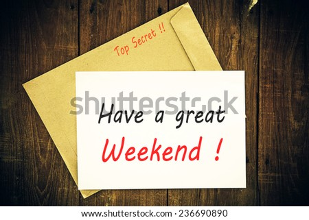 Have a great Weekend - Hand writing text on a piece of paper on wood background - stock photo