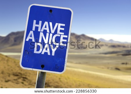 Have a Nice Day sign with a desert background