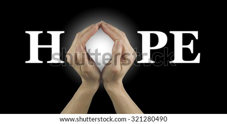 Have some HOPE - female hands making an 'O' shape in the word HOPE on a black background  - stock photo