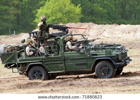 HAVELTE, THE NETHERLANDS - MAY 29: Dutch Army Mercedes 4x4 during an Air Power demonstration at the Dutch Army Days on May 29, 2010 in Havelte, The Netherlands - stock photo