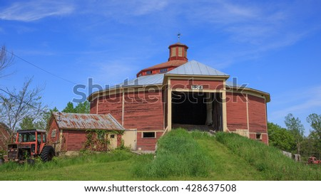 HAVERHILL, NEW HAMPSHIRE May 26th: Historic round red barn in New Hampshire build in 1906 on May 26th, 2016 in Haverhill, New Hampshire. - stock photo