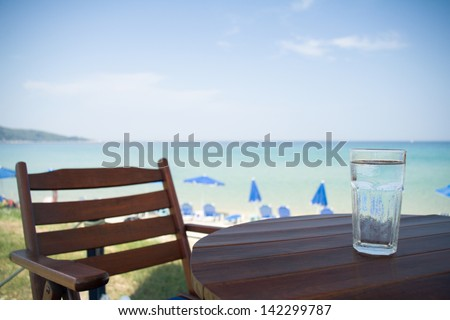 Having a glass of water in shade on a beach