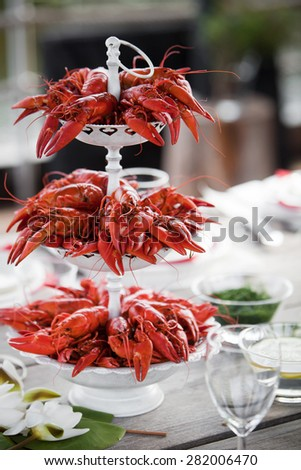 Having a summer party with lots of crayfish - stock photo