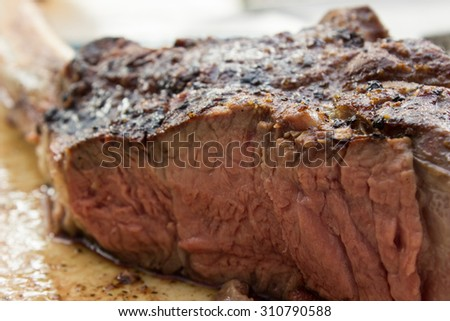 Having barbecue with a delicious steak - stock photo