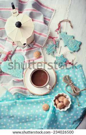 Having coffee at Christmas morning: cup of espresso set with handmade ceramic decorations and italian coffeemaker, toned photo - stock photo
