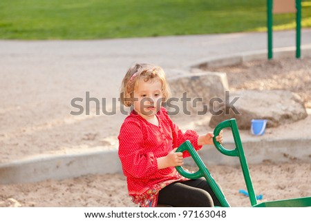 Having fun at playground in the park on Sunday afternoon. - stock photo