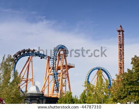 Having fun in a huge amusement park - stock photo