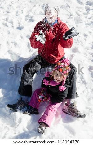 Having fun playing on the snow in ski resort. - stock photo