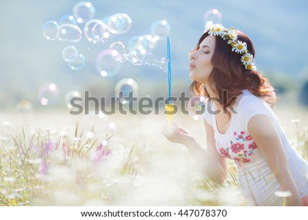 Having fun. Portrait of beautiful pregnant woman in field blowing bubbles.Young pregnant woman relaxing in park outdoors, healthy pregnancy. Happy pregnant woman with bubbles on nature.  - stock photo