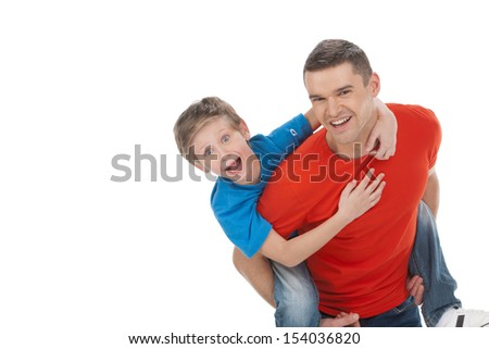 Having fun together. Cheerful father and son having fun together while isolated on white - stock photo