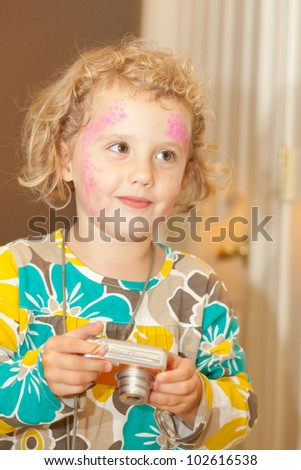 Having fun with face paited on harvest festival. - stock photo