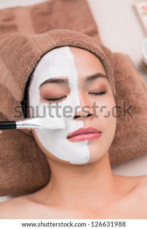 Having mask on a female face - stock photo