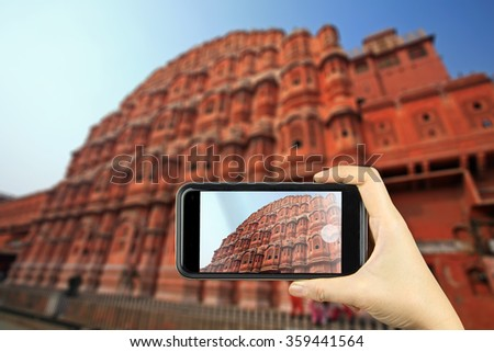 Hawa Mahal or Palace of Winds, Jaipur, India. Taking photo on smart phone concept.    - stock photo