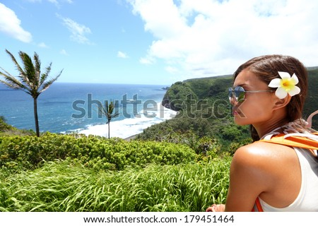 Hawaii Big Island - woman looking at view of beautiful Hawaiian landscape nature beach on Big Island during vacation travel. - stock photo