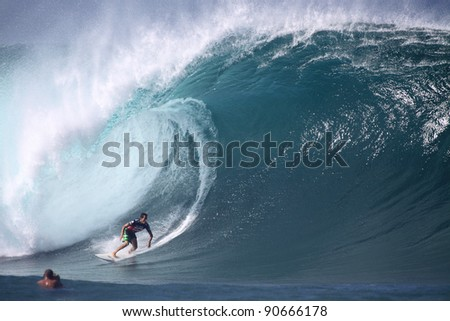 HAWAII - DECEMBER 9: Evan Valiere competes in the Billabong Pipemasters on December 9, 2011 at Pipeline, Hawaii. This years event produced some of the biggest waves in recent years. - stock photo