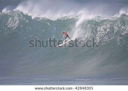 HAWAII - DECEMBER 8: Reef Macentosh competes in the Quicksilver Eddie Aikau Big Wave Invitational on December 8, 2009 at Waimea Bay, Hawaii. - stock photo
