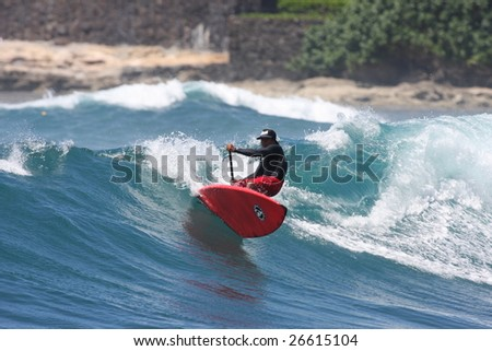 Hawaii - Mar. 10: Stand Up Paddle surfing has emerged as a popular new sport March 10, 2009 at Makaha Beach in Hawaii. - stock photo