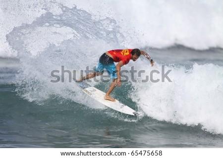 HAWAII - NOV. 17: Cory Lopez competes in the Reef Hawaiian Pro  November 17, 2010 at Haleiwa Beach, Hawaii - stock photo