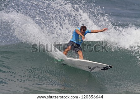 HAWAII - NOVEMBER 24: Australia's Tom Whitaker competes in the Reef Hawaiian Pro, stage one of the Vans Triple Crown of Surfing November 24, 2012 at Haleiwa Beach Park.