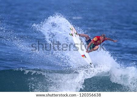 HAWAII - NOVEMBER 24: Professional surfer Sebastien Zietz wins the Reef Hawaiian Pro, stage one of the Vans Triple Crown of Surfing November 24, 2012 at Haleiwa Beach Park. - stock photo