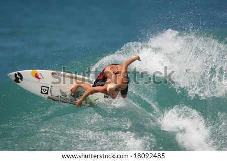 Hawaii - Oct. 23: Pro women's surfer Keala Kennelly rips a wave Oct. 23, 2007 at Off The Wall, Hawaii. She is one of the best pro women surfers on the tour. - stock photo