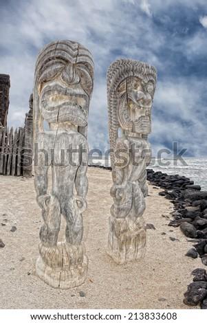 Hawaii Polynesian Tiki wooden statue on the shore - stock photo