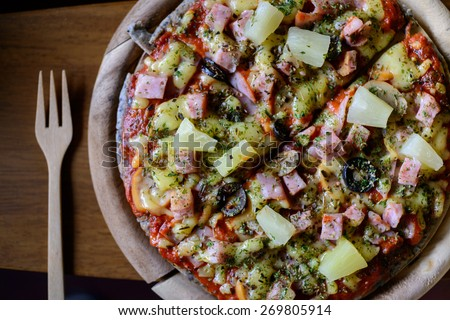 Hawaiian pizza thin crispy thin crust, Italian Restaurant. - stock photo