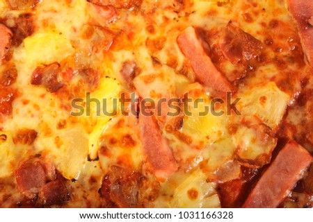 Hawaiian pizza topped with pineapple and ham