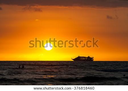 Hawaiian sunset and sunset cruise - stock photo