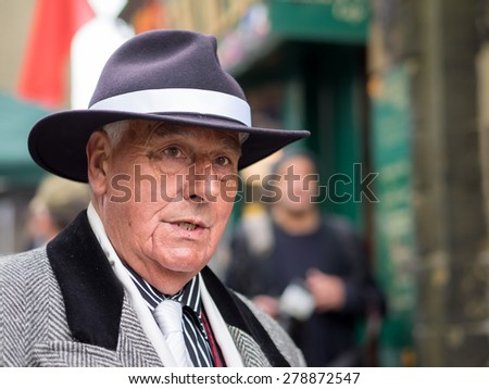 Haworth UK - May 17, 2015: Mature gentleman in hat and vintage clothing at a 1940s themed event