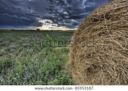 Hay Bale and Prairie Storm - stock photo