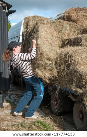 Hay delivery being unloaded