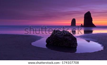 Haystack Rock at sunset Cannon Beach Oregon - stock photo