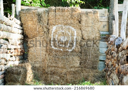 Haystack wall with painted target circle - stock photo