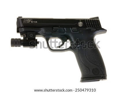 Hayward, CA - February 3, 2015: Smith & Wesson M&P 22, a .22 caliber training semi-automatic pistol equipped with a laser site -illustrative editorial - stock photo