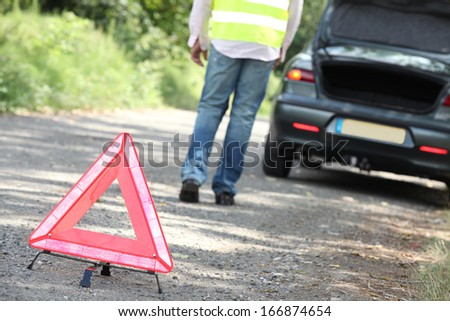 Hazard triangle at a breakdown - stock photo