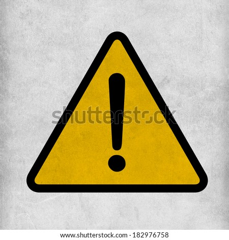 Hazard warning attention sign with exclamation mark symbol on grunge metal dirty background - stock photo