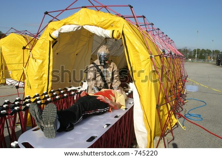 Hazardous material team mock drill with portable decontamination chamber. Editorial use only. - stock photo