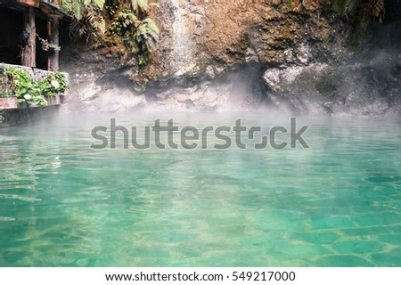 Haze over the natural pool of Fuentes Georginas hot springs around Zunil and Quetzaltenango, Guatemala. Central America