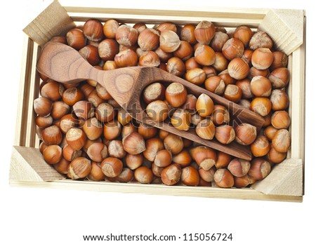 Hazelnut filbert on wooden crate isolated on white background - stock photo
