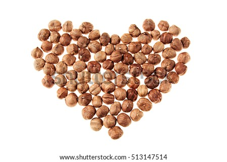 Hazelnut heap in heart shape on white background. Isolated. Valentine's Day.
